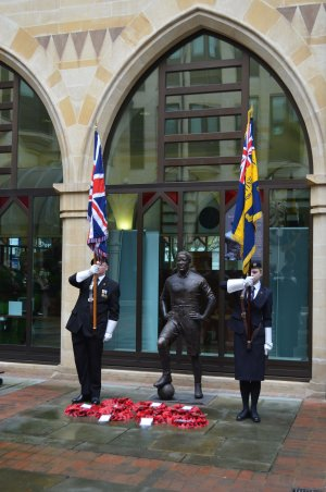 A guard of honour and wreaths at the memorial ceremony at Walter Tull's statue at Northampton Guildhall